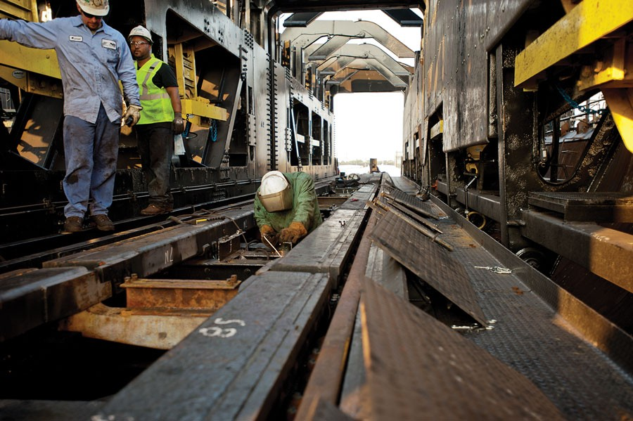 Mechanical Department employees inspect and maintain twin coal dumpers at Pier 6