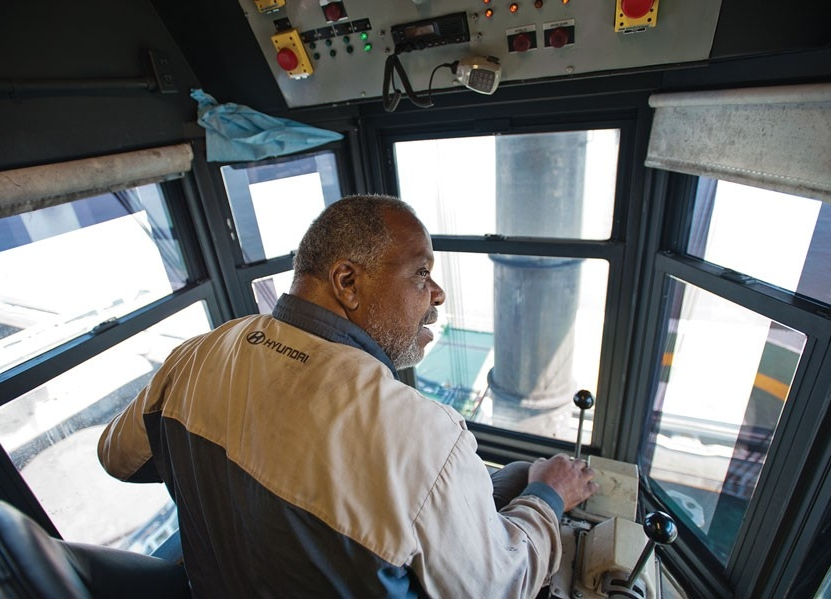 Leo Carman, sits in the cab of one of Pier 6's coal loaders